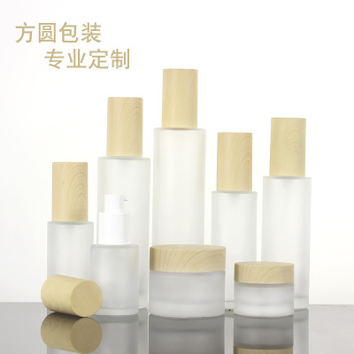 The customized LOGO spray bottle emulsion bottle can be customized to New stock wooden cap cosmetic glass bottle frosting bottle