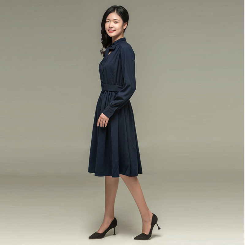 Long-sleeved bow dress